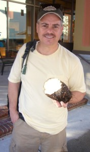 Dan Dowling holding part of a Winged Yam root, photo by Green Deane