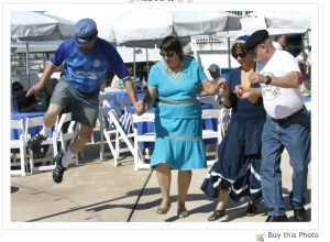 Doing whata he's told Green Deane takes a flying leap at a Greek Festival.